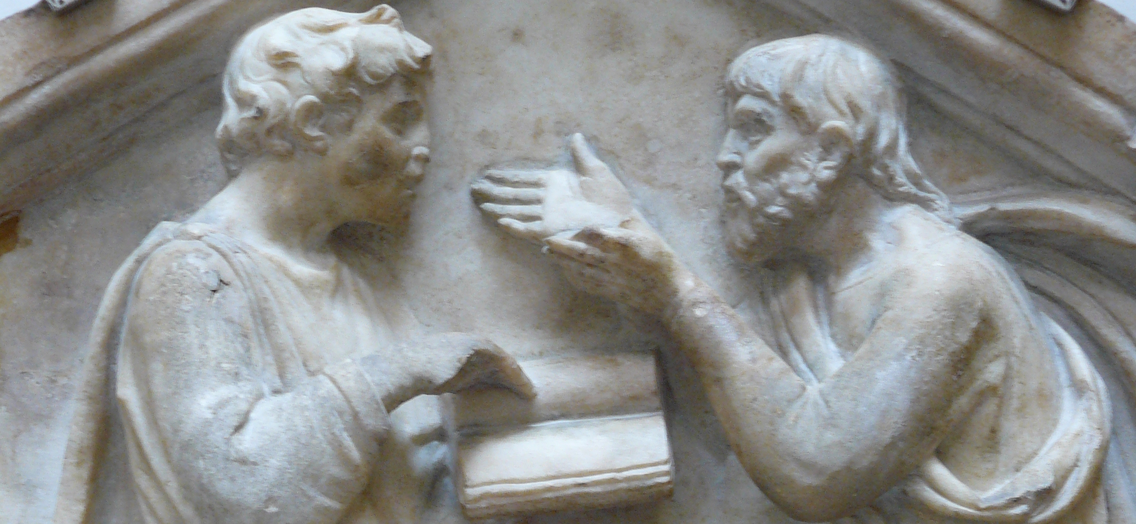 bas relief of disputing the text