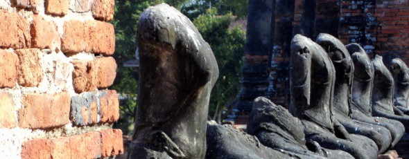 row of headless Buddhas in Thailand