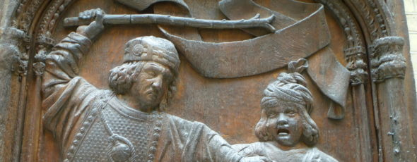 relief sculpture of man hitting child