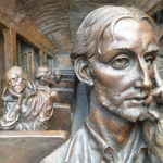 Bronze relief sculpture by Paul Day in St. Pancras station, London