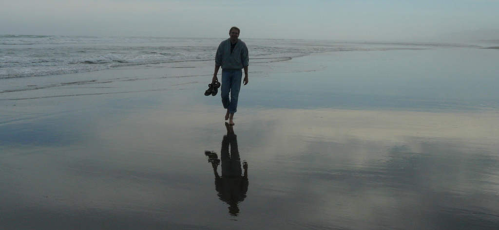 walking on beach with reflection